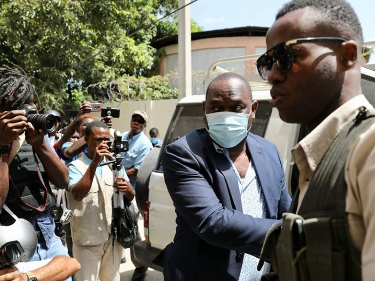 Haiti prosecutor seeks to charge PM in killing, is replaced