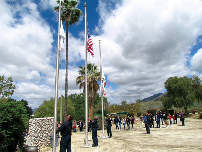 Members of Soboba Fire Dpt raise flag at ceremony