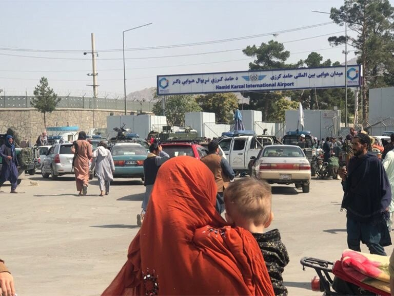 Deadly gunfire at airport; Taliban insist on US pullout date